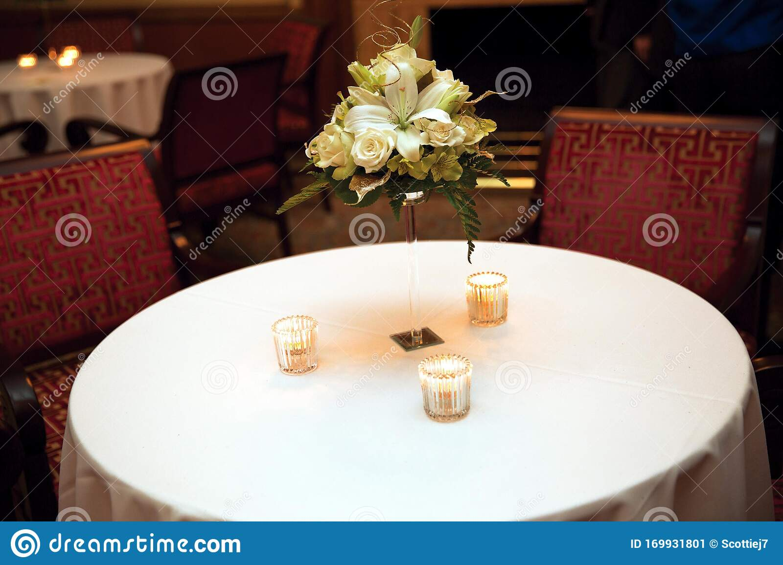 Picture of: Dinner Table With A Center Piece And Candles Stock Image Image Of Glass Cloth 169931801
