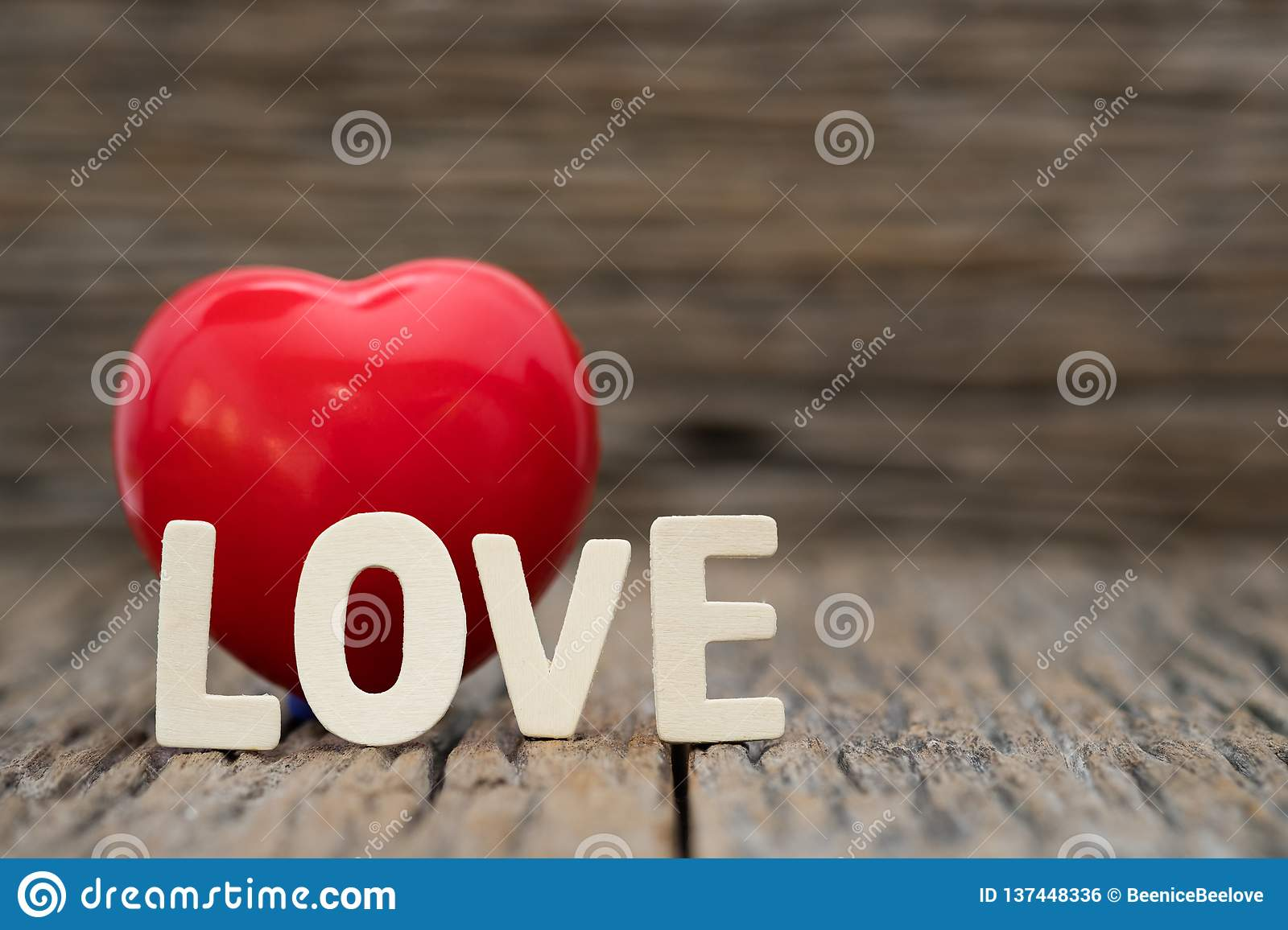 Image-One Heart and love word on wooden background. Copy space Valentines day