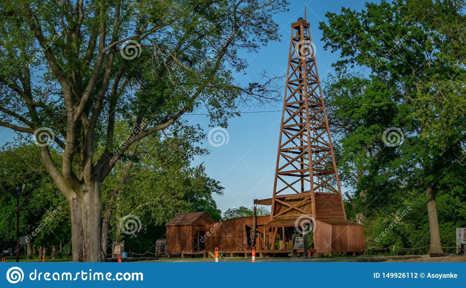 Image Of Park & Wooden Oil Well, Shot At Pathfinder Parkway