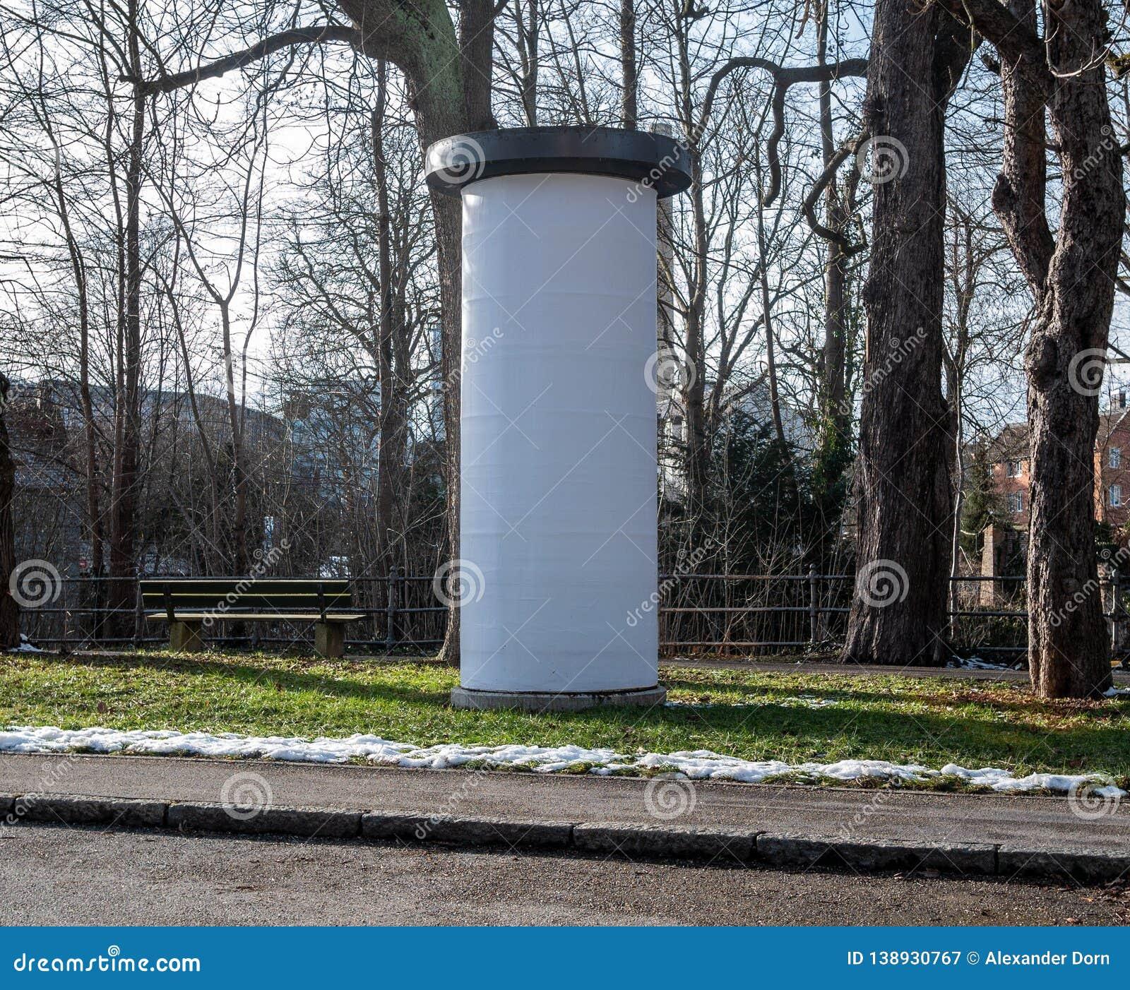 Image of Photo blank white mockup poster of street advertising column stand on sidewalk