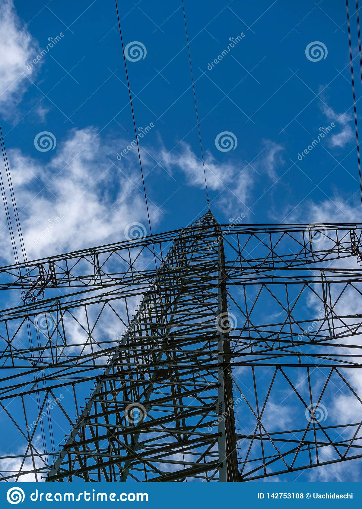 Image of power pole with cloudy background