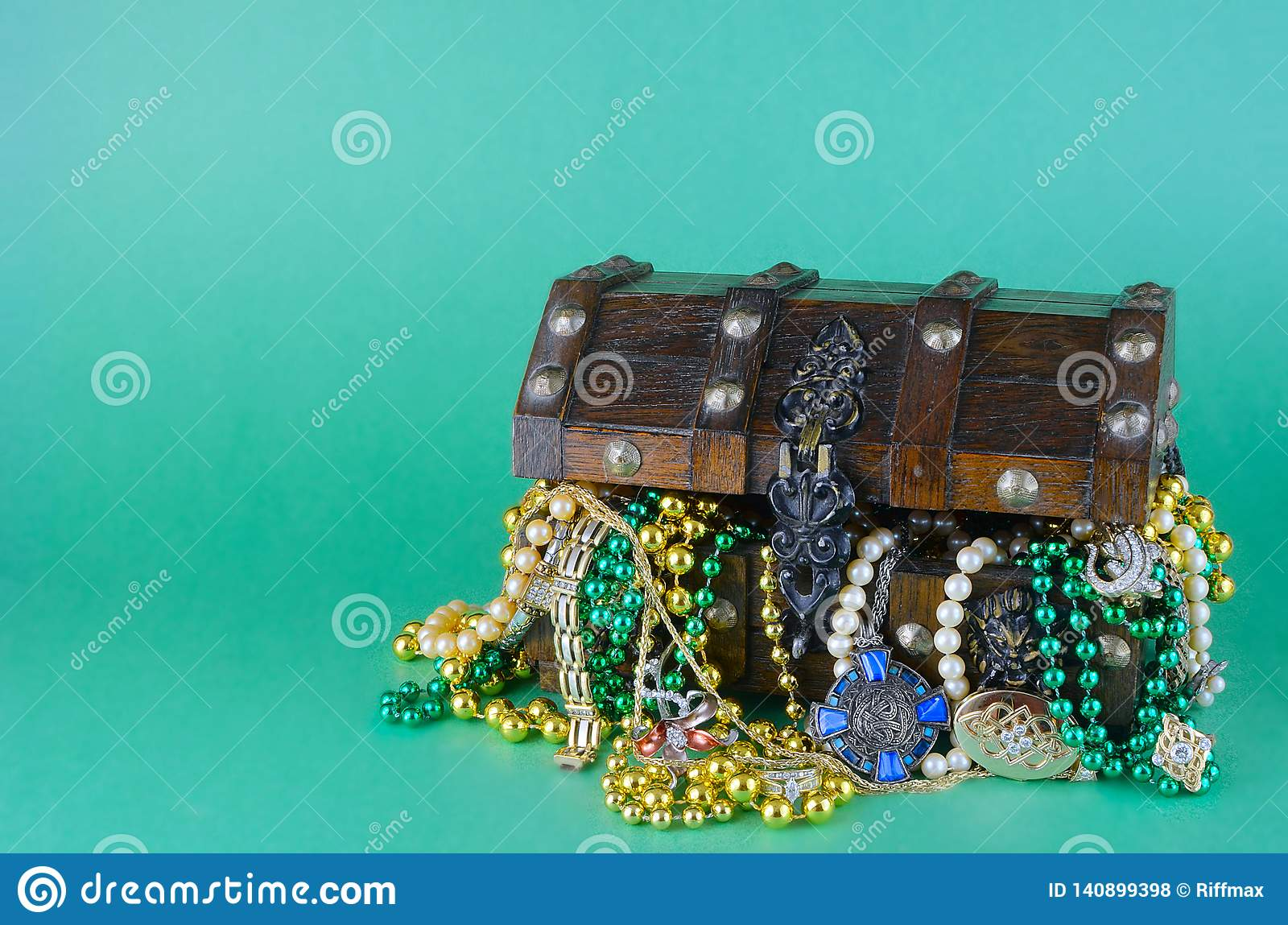 Image for Saint Patrick`s Day on March 17th. Treasure chest to symbolize luck and wealth is filled with costume jewelry and beads.