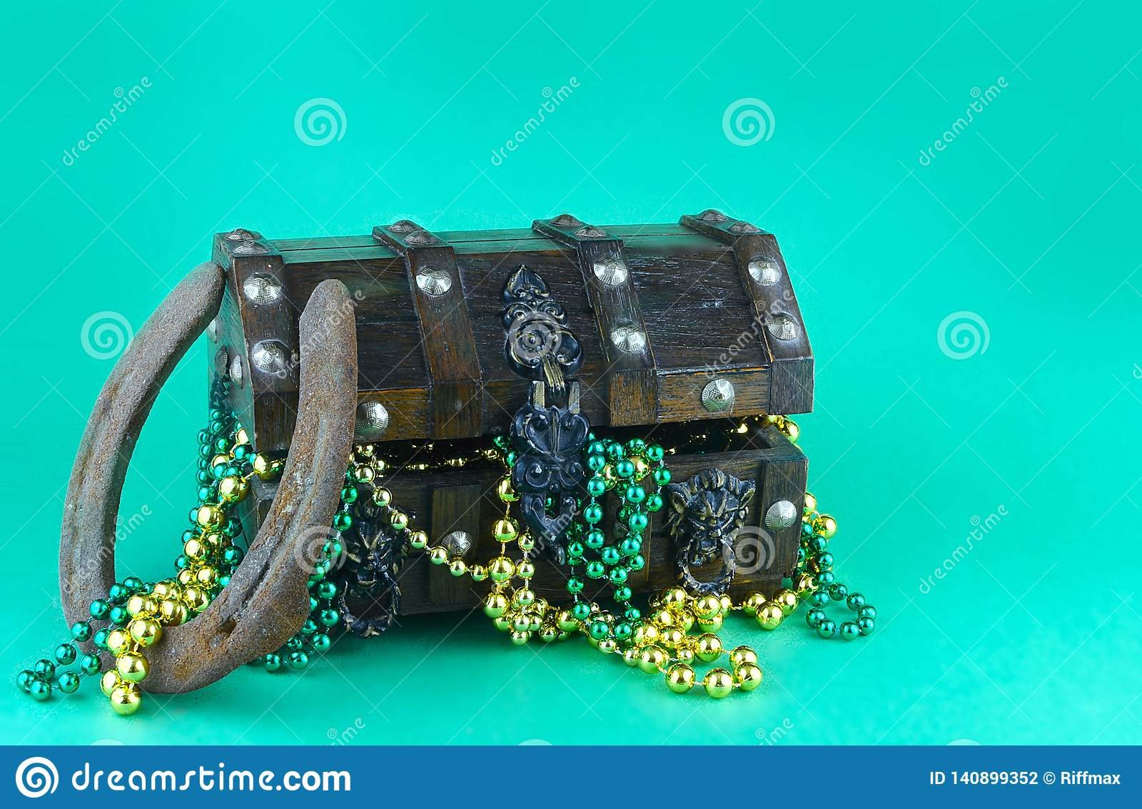 Image for Saint Patrick`s Day on March 17th. Treasure chest to symbolize luck and wealth filled with shiny beads.