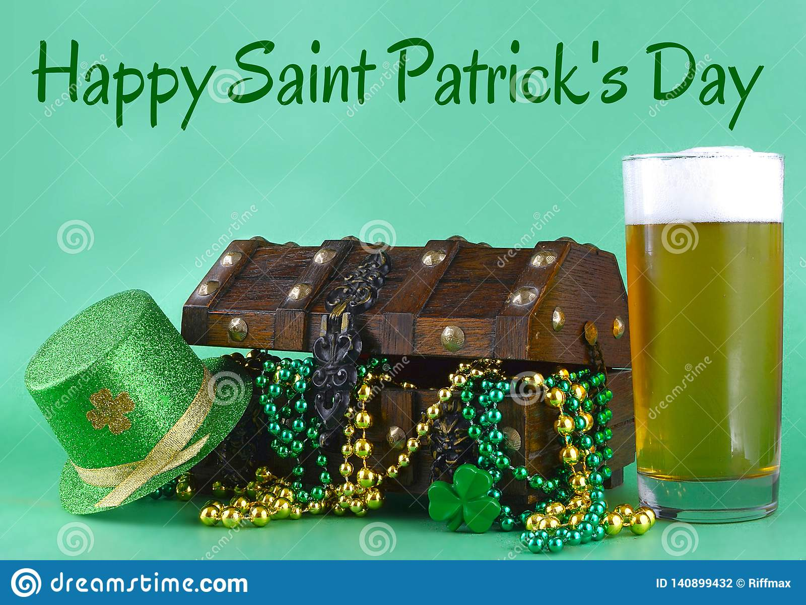 Image for Saint Patrick`s Day on March 17th. Treasure chest to symbolize luck and wealth. A glass of beer and green hat added.