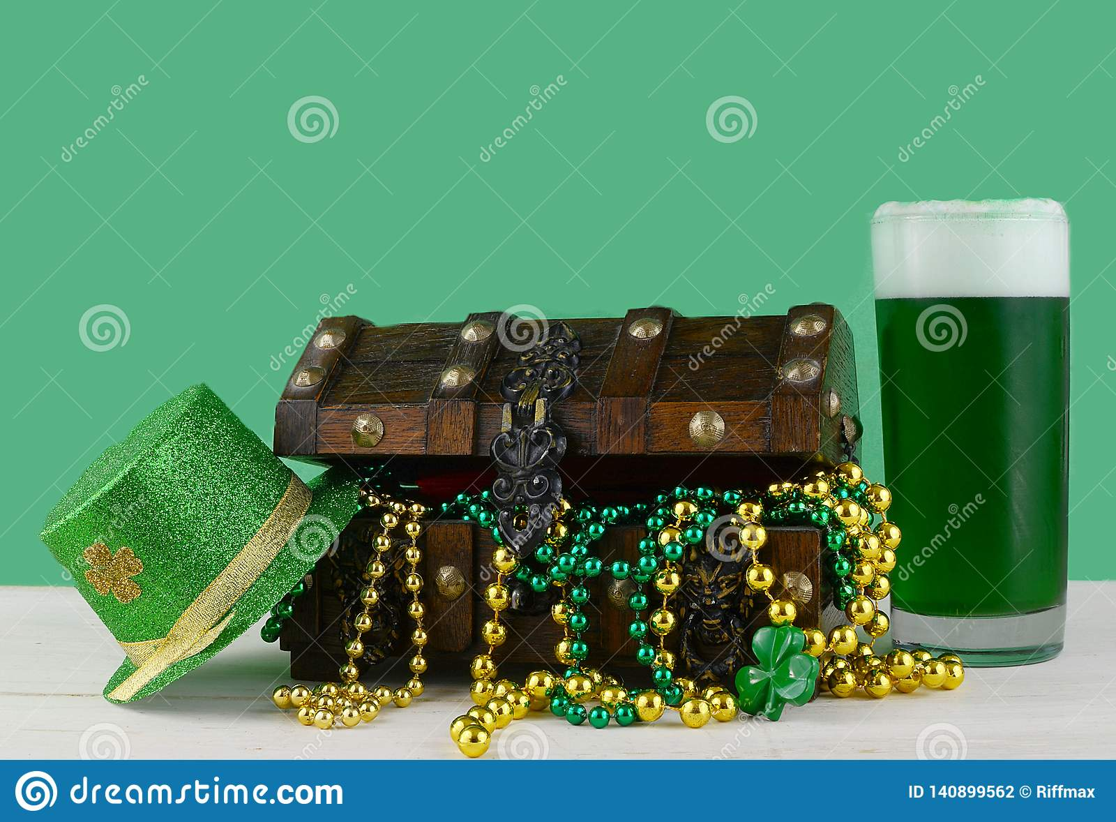 Image for Saint Patrick`s Day on March 17th. Treasure chest to symbolize luck and wealth with a glass of green beer.