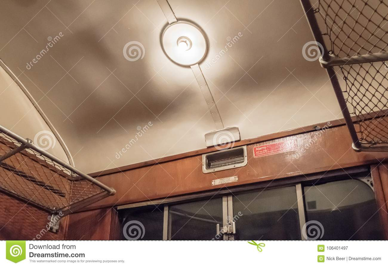 Internl view of a First-Class passenger train compartment from the steam era.