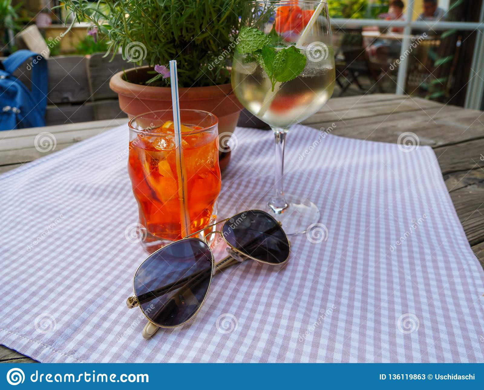 Image of summer drinks and sunglasses on table