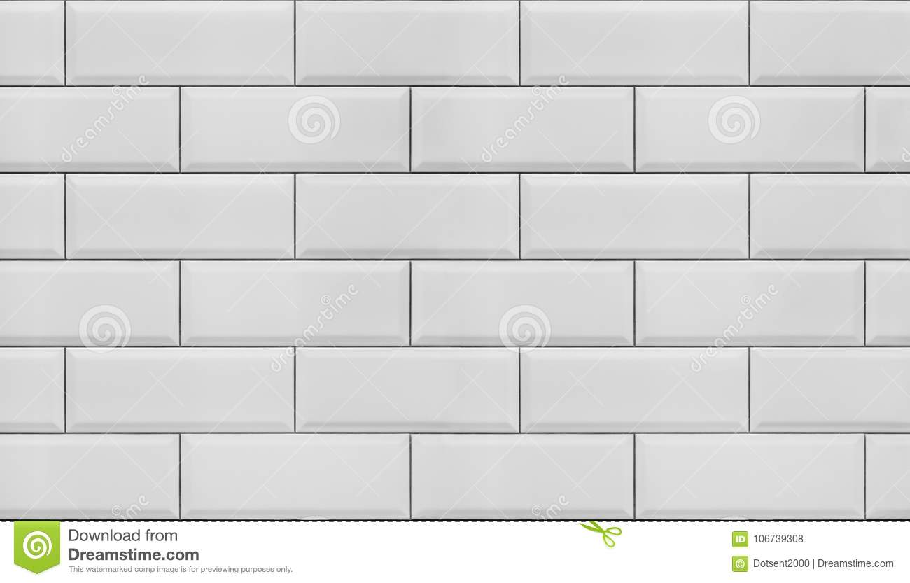 Wall of white tiles.