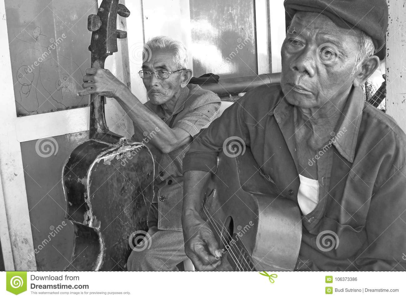 Two Old Street Musician And Their Old Guitars Editorial