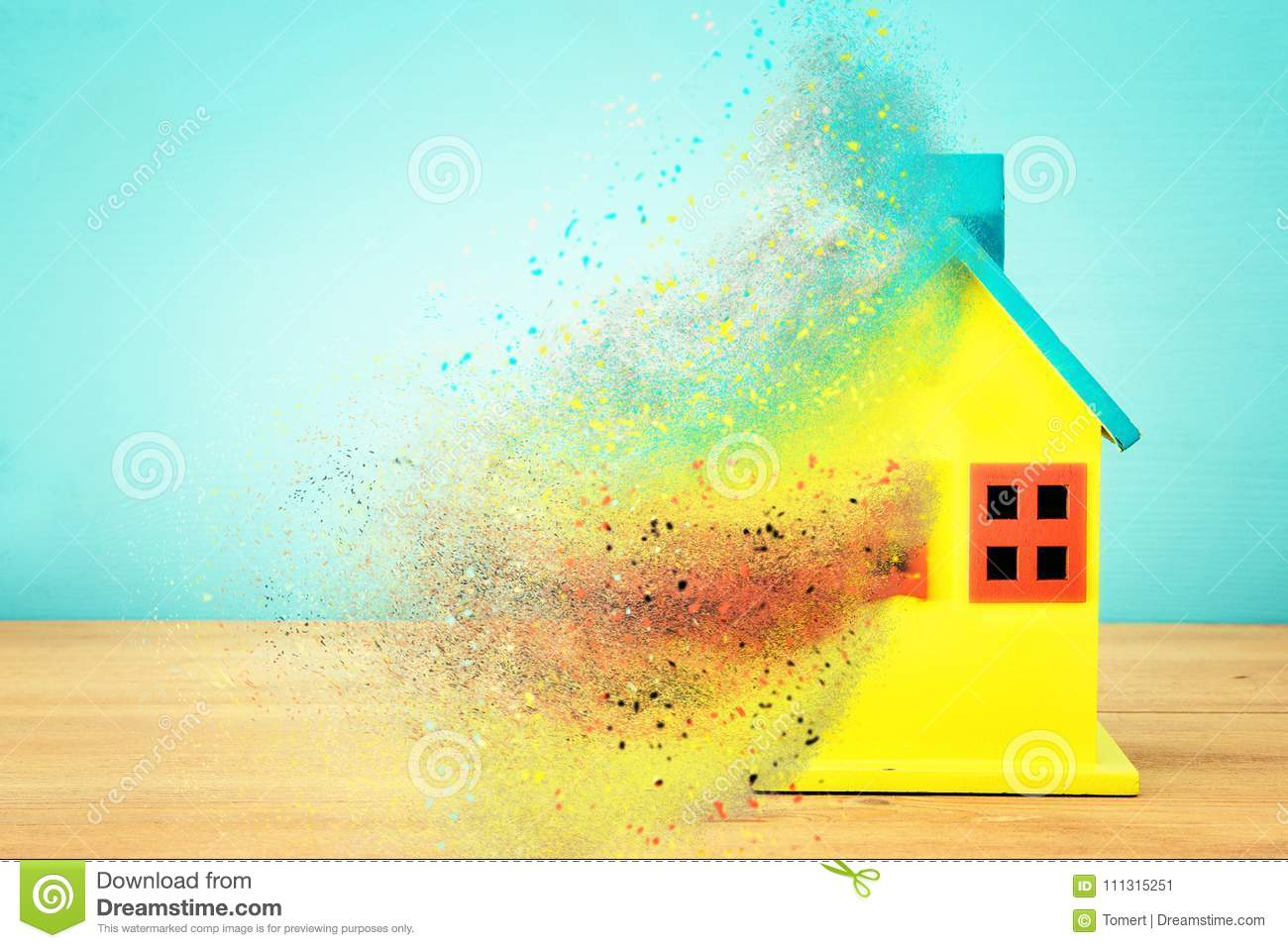 Image of wooden colorful house model. Real estate and uncertainty concept.