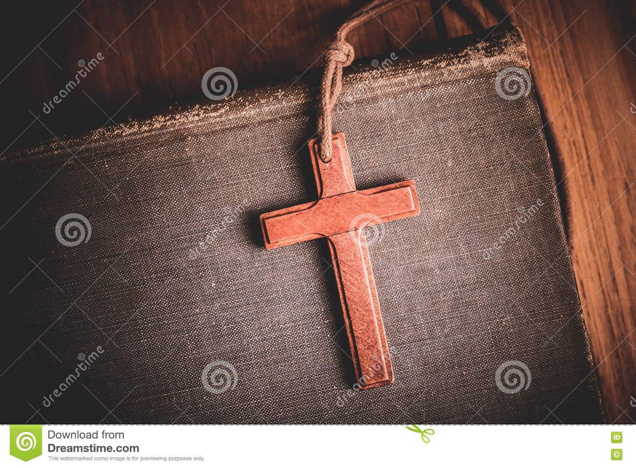 Image of wooden cross on bible background