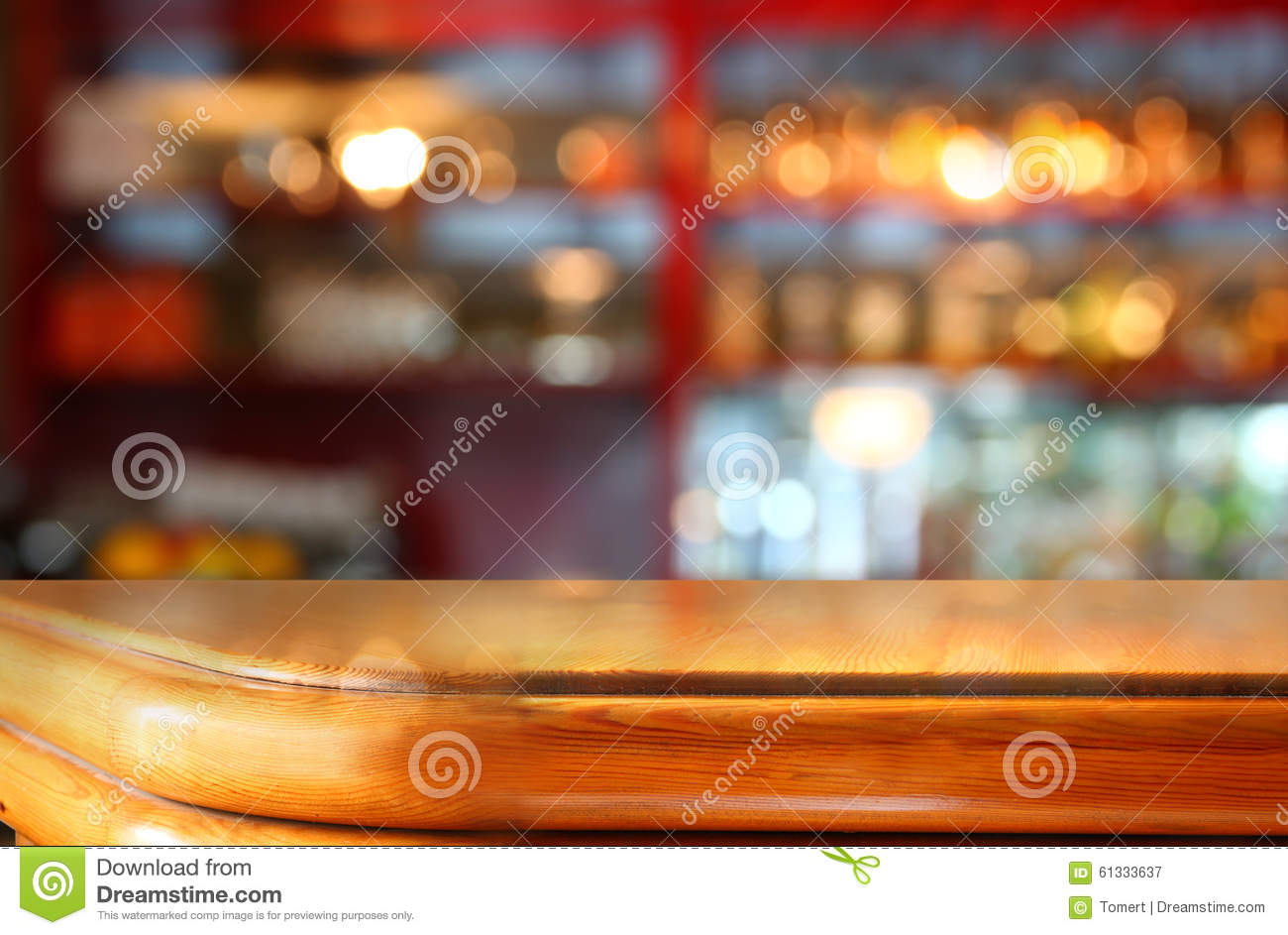 Image Of Wooden Table In Front Of Abstract Blurred ...