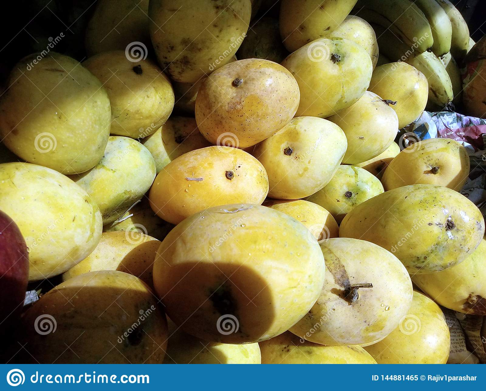 This is the image of yellow mango with some banana