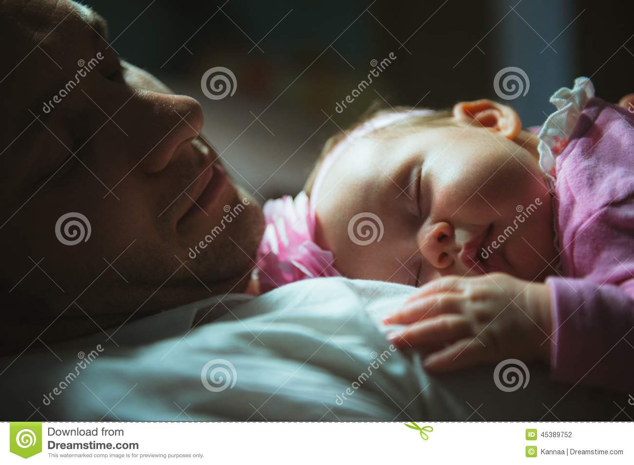 Image of young dad with cute little daughter in