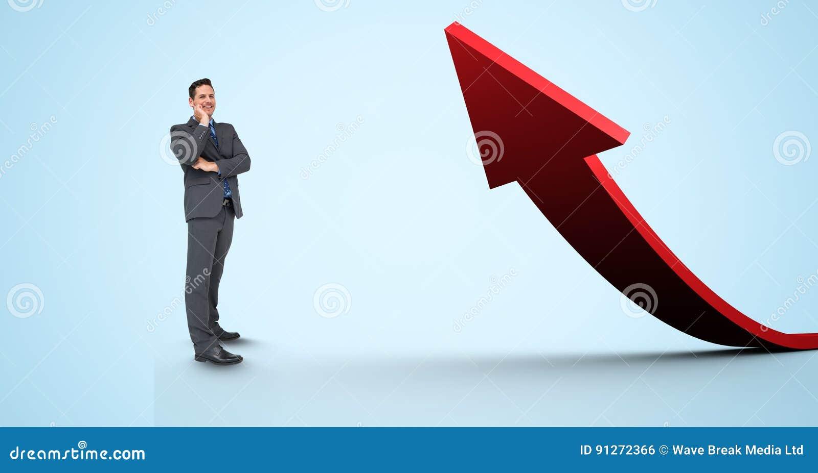 Imagem composta de Digitas do homem de negócios que está pela seta vermelha