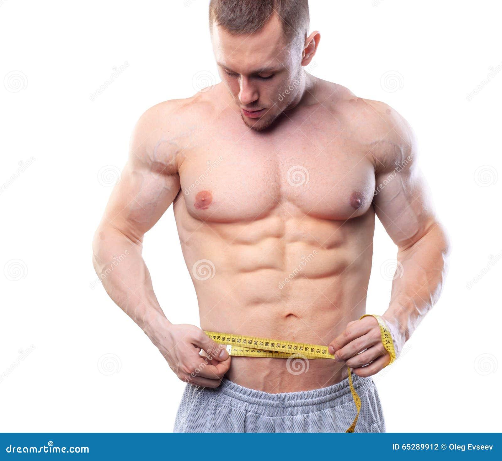 aa0d73809 Imagem da medida muscular do homem sua cintura com a fita de medição nos  centímetros Tiro