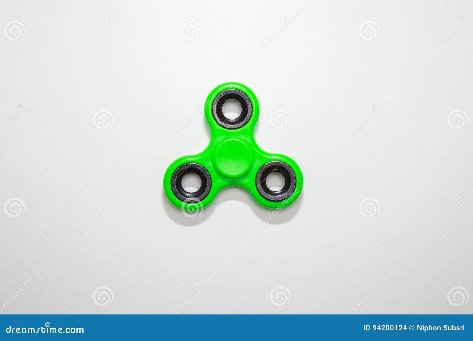 Imagem verde do brinquedo do girador do dedo da inquietação