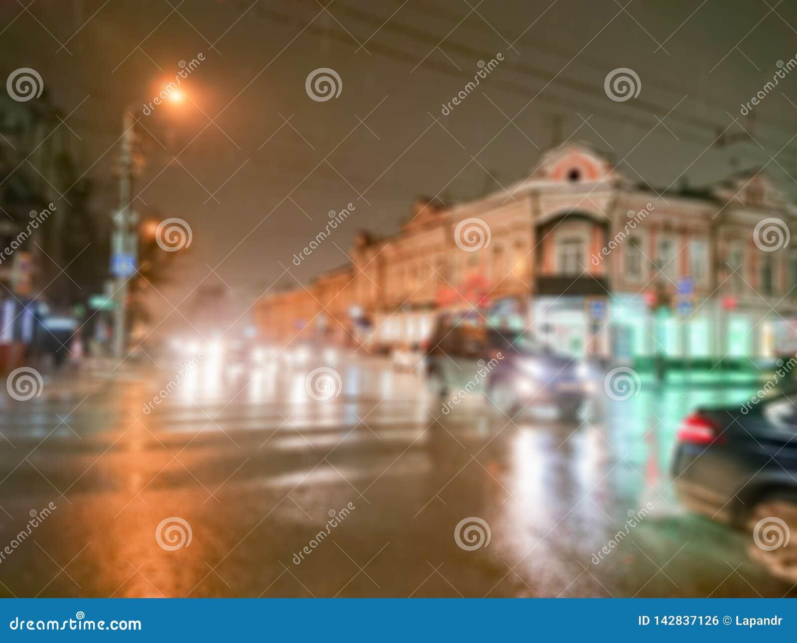 Imagen abstracta Defocused Efecto de Bokeh Fondo enmascarado Igualación de paisaje urbano en tiempo lluvioso Coches y luces de la
