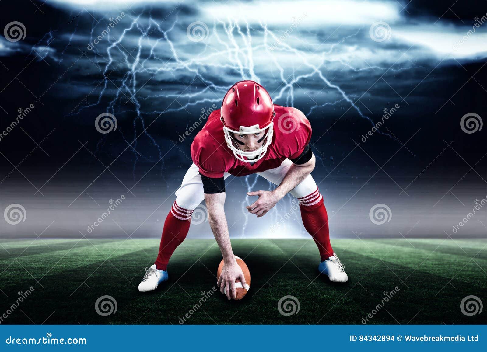Imagen compuesta del jugador de fútbol americano que comienza el partido de fútbol 3d