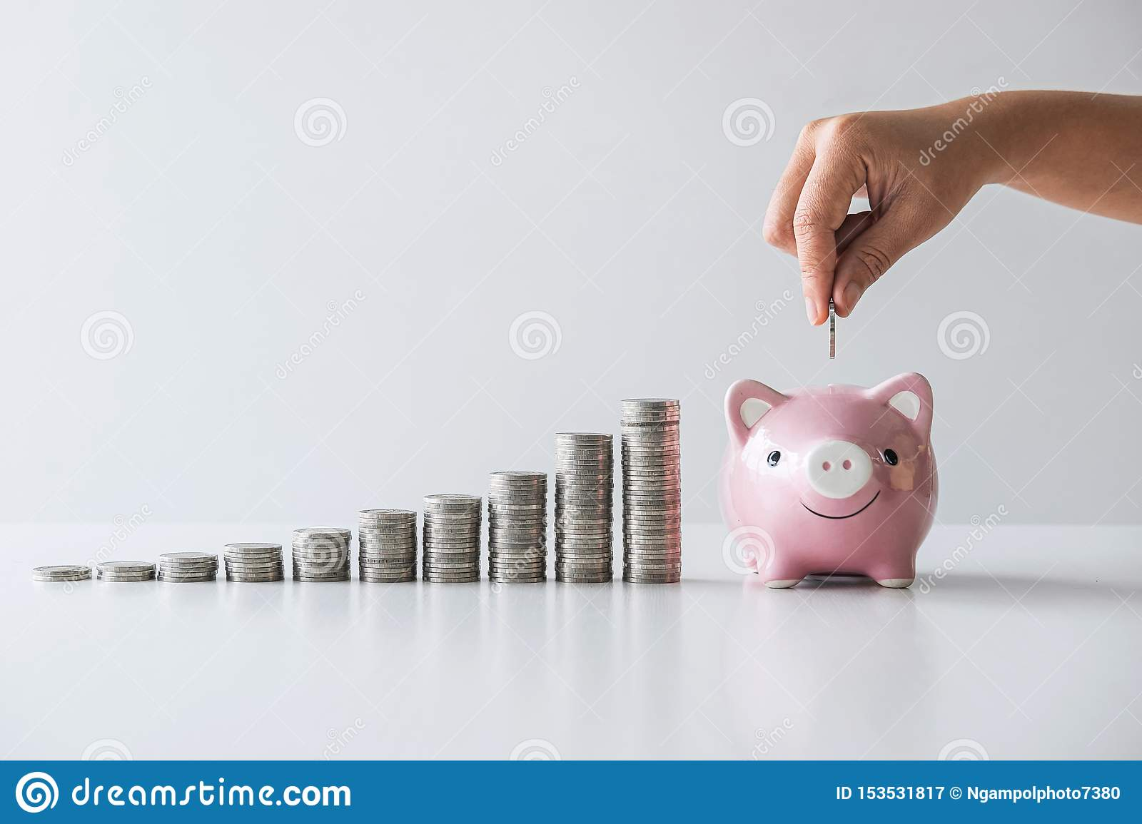 Images of stacking coins pile and Hand putting coin into pink piggy bank for planning step up to growing and savings with money