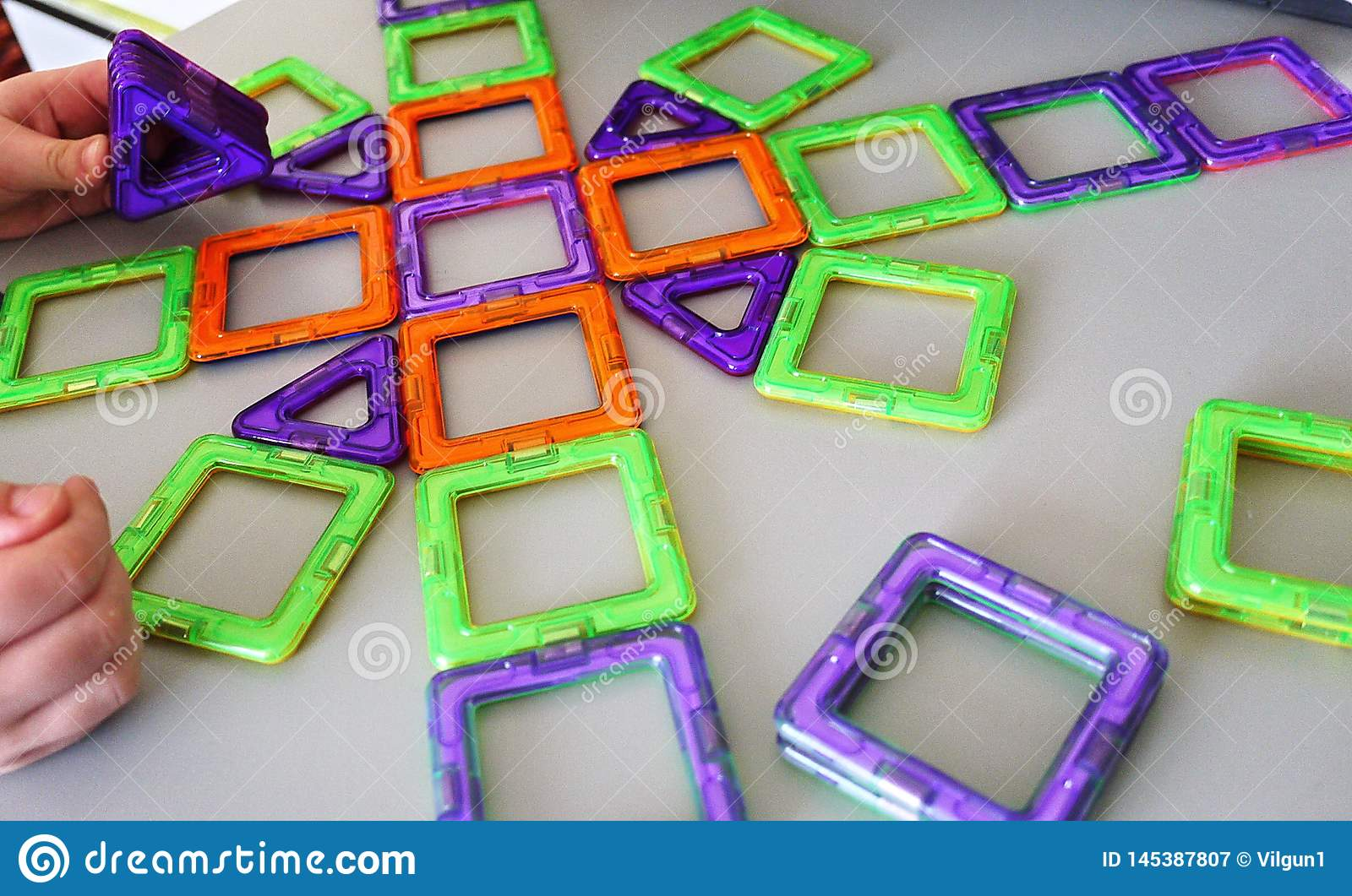 Bright geometric shapes on a magnetic base. Of these figures, the designer can assemble the various . Perfect for the develo
