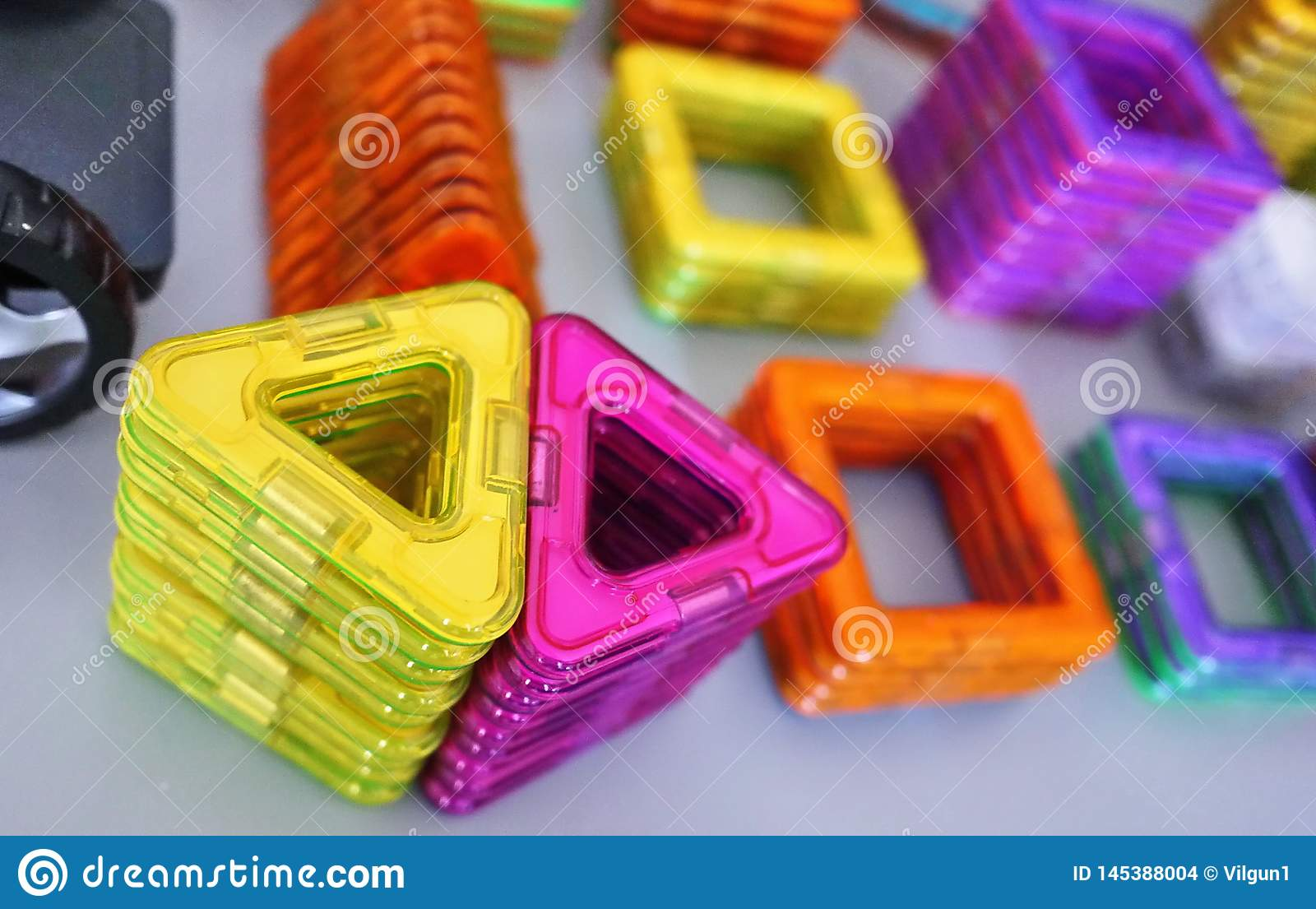 Bright geometric shapes on a magnetic base. Of these figures, the designer can assemble the various models. Perfect for the develo