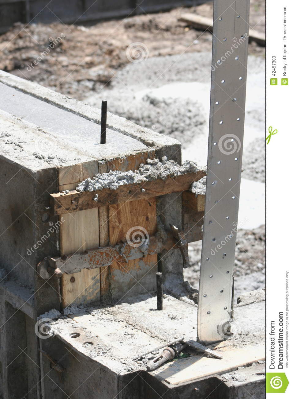 Imbededded tie down strap stock photo image of concrete for Basement wall forms