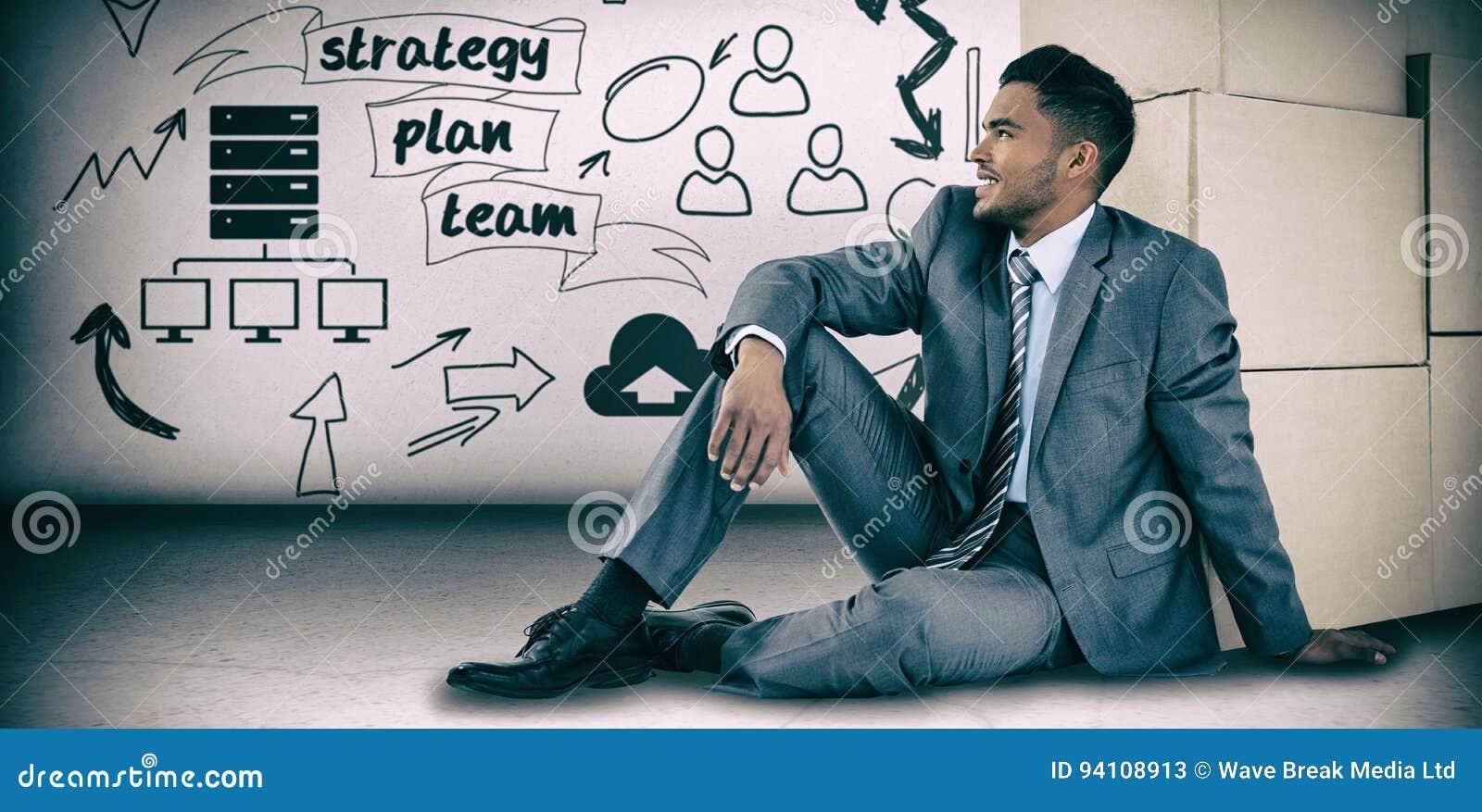 Immagine composita dell uomo d affari che si siede vicino alle scatole di cartone contro il fondo bianco