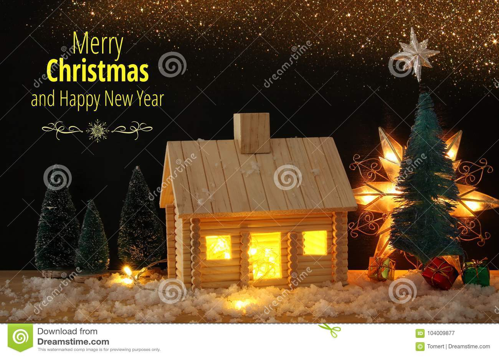 Immagine dell 39 albero di natale e della casa di legno con luce attraverso la finestra sopra la - Libro la luce alla finestra ...