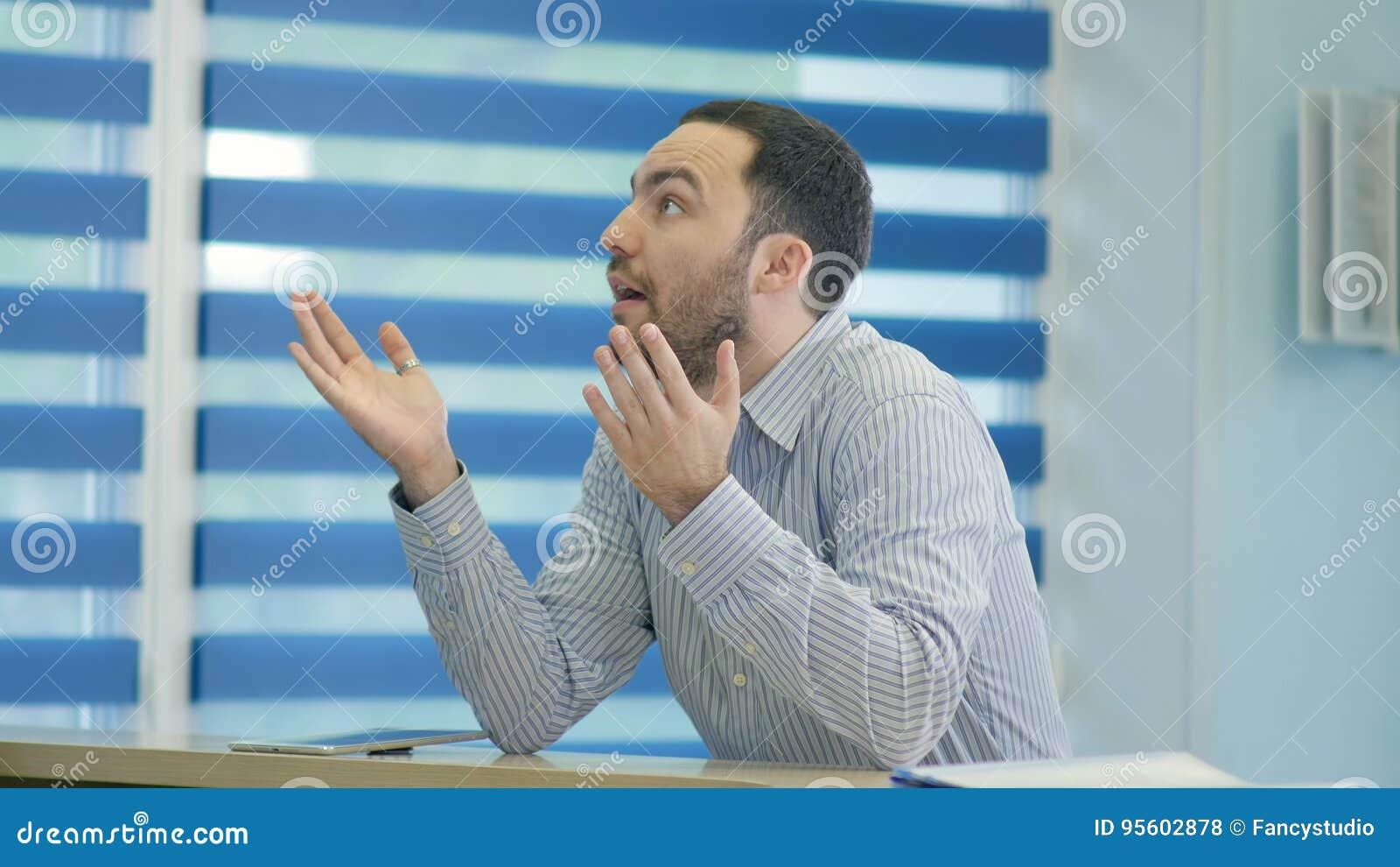 Impatient male patient waiting at the reception desk