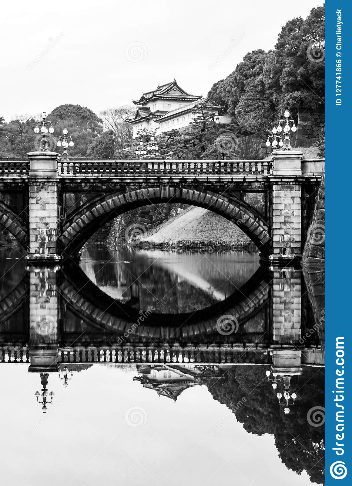 Imperial Palace & Bridge with peaceful moat reflection, Tokyo, Japan - B&W
