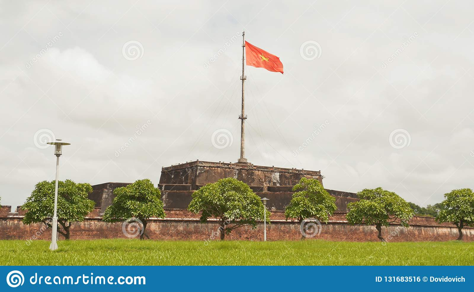 Imperial Royal Palace of Nguyen dynasty in Hue and fkag. Vietnam.