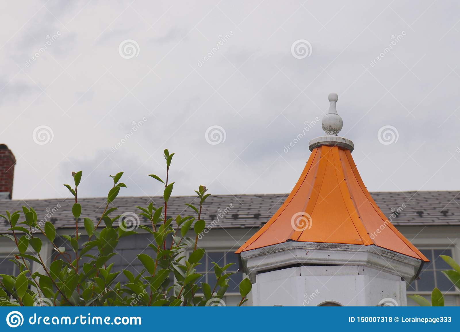 Imposing Orange Steeple Interrupts the Grey Sternness of This Sky and Rooftop Scene