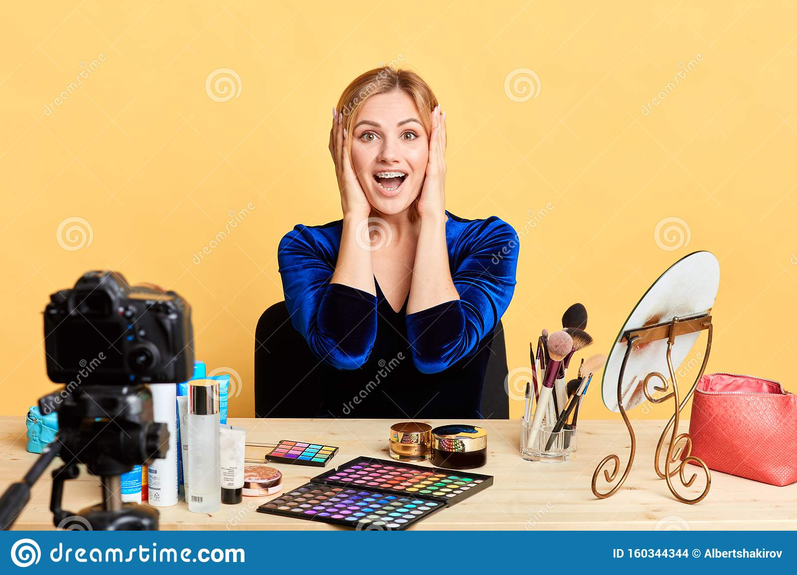 Impressed Blogger Sits In Makeup Room With Palms Near Face Expresses Happiness Stock Photo Image Of Followers Concept 160344344