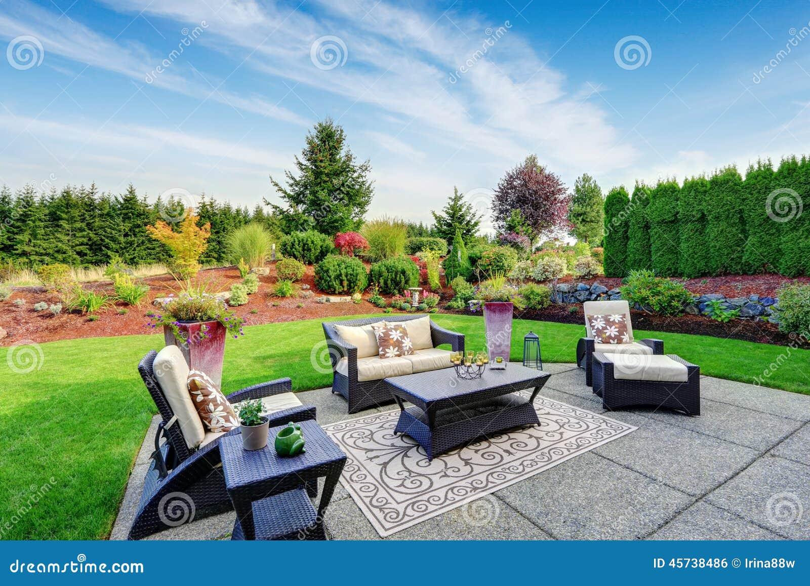 impressive backyard landscape design with patio area stock photo image 45738486. Black Bedroom Furniture Sets. Home Design Ideas