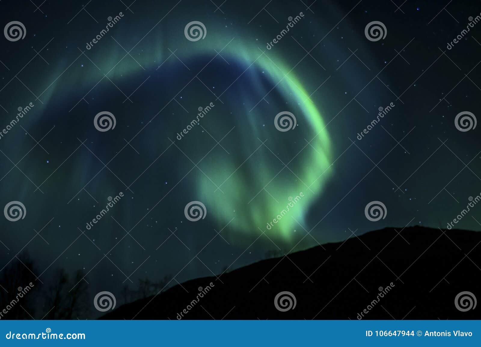 BLUE AURORA IN THE ARCTIC SKY