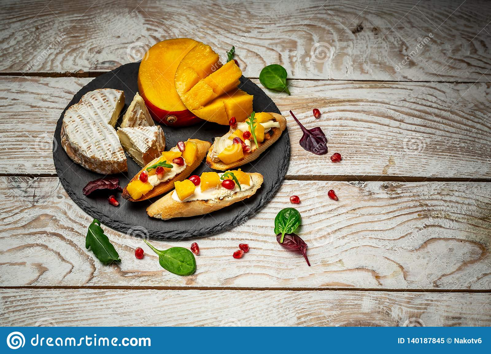 Impressive Cheese Plate Or Cheese Platter Snacks For Wine Brushetta With Mango Camembert Cheese And Pomegranate Served On A Stock Image Image Of Antipasto Sandwich 140187845