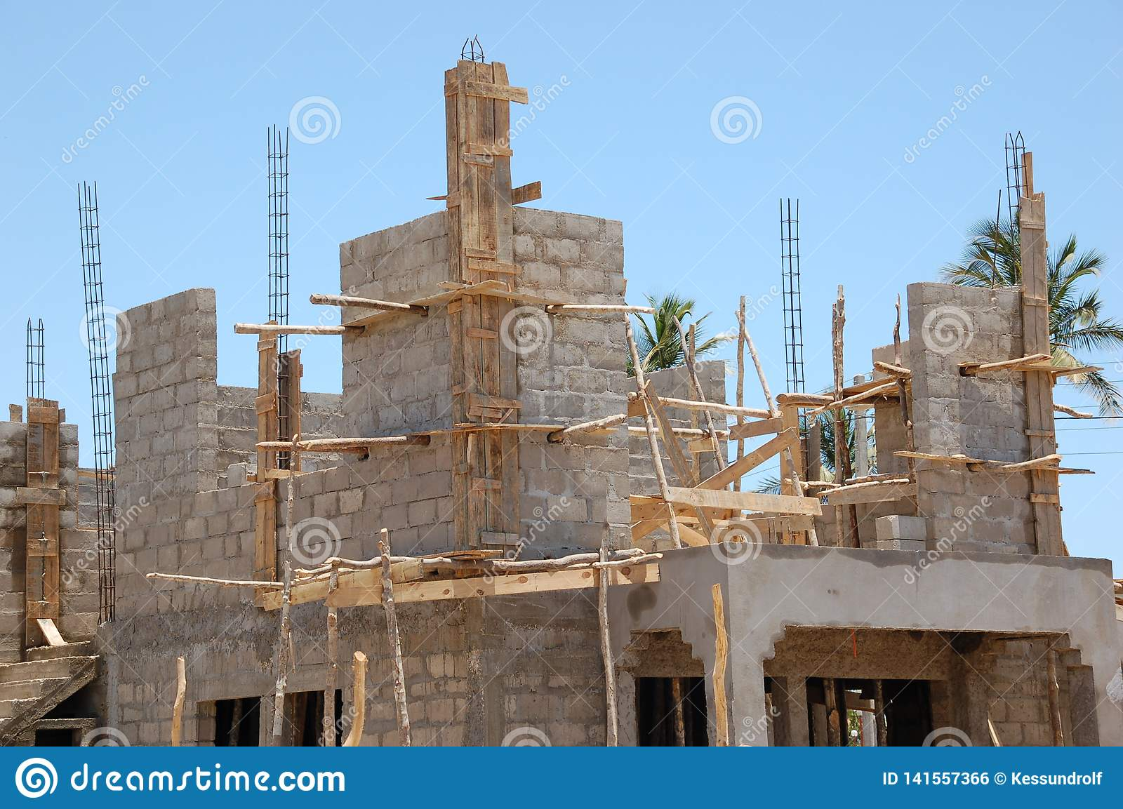 Building site with wooden framework and blue sky