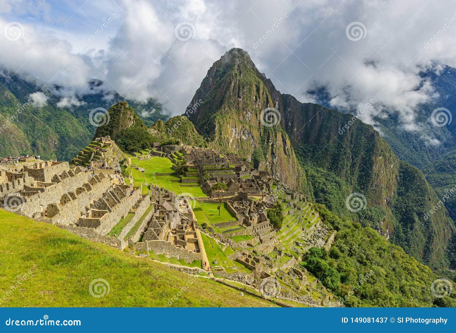 Inca Ruin av Machu Picchu med dramatiska moln, Cusco, Peru