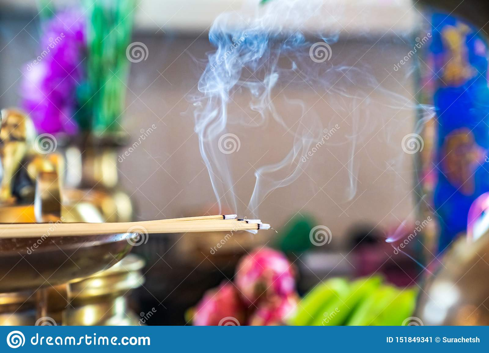 Incense On The Brass Candlestrick With The Smoke Out From