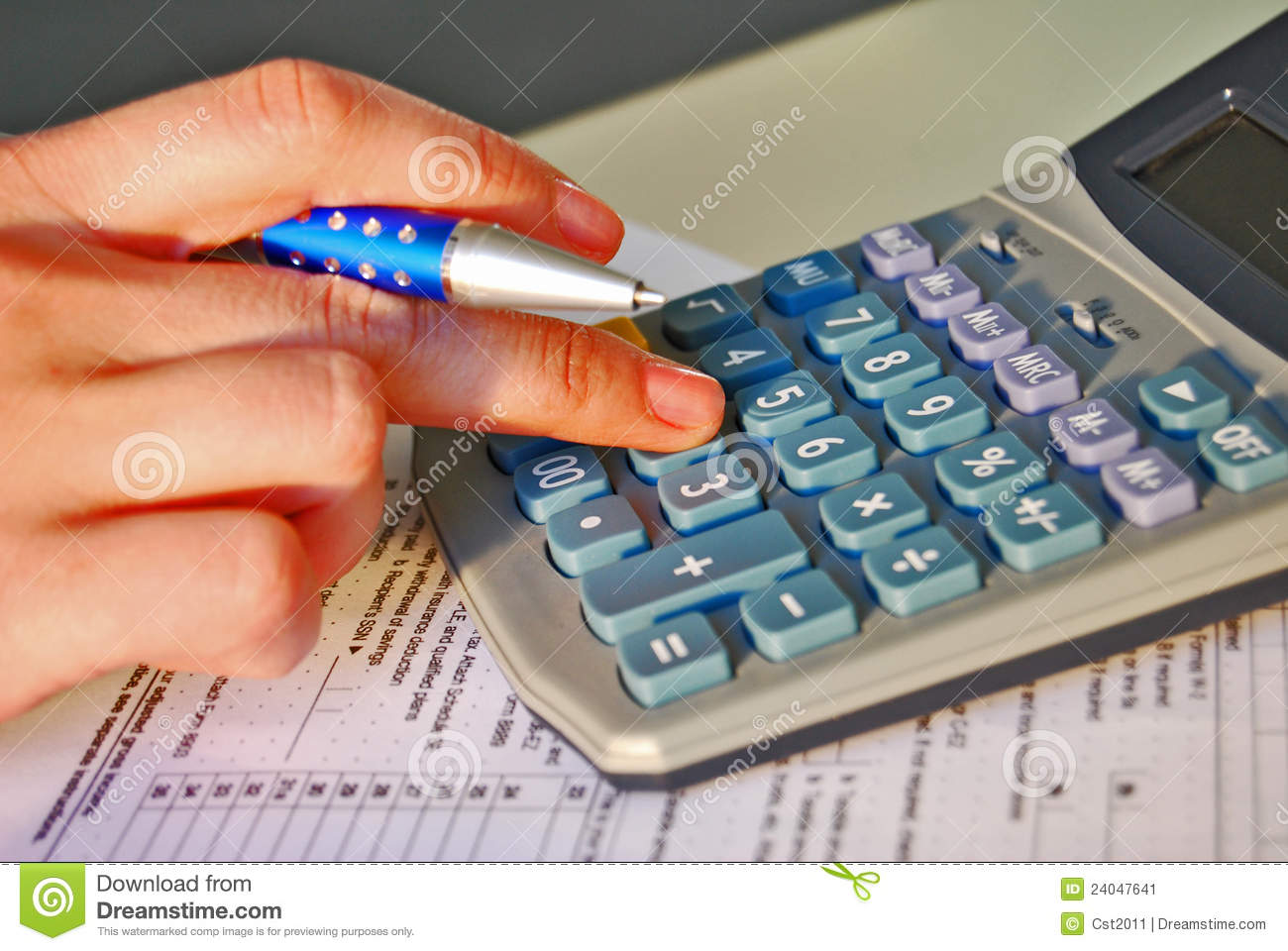Woman calculated income tax.