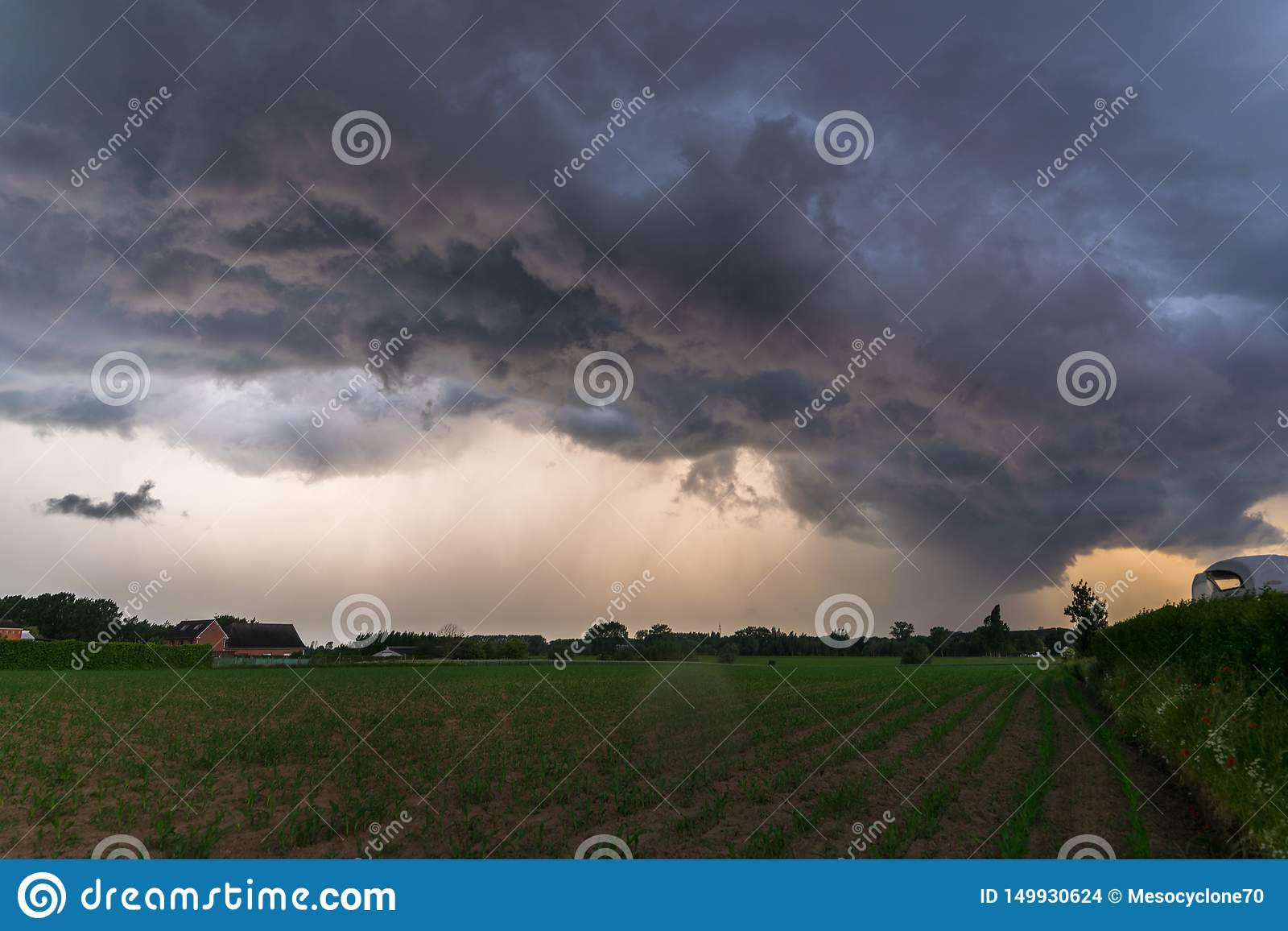 Dramatic sky as threatening storm clouds are moving fast over the landscape of Flanders, Belgium