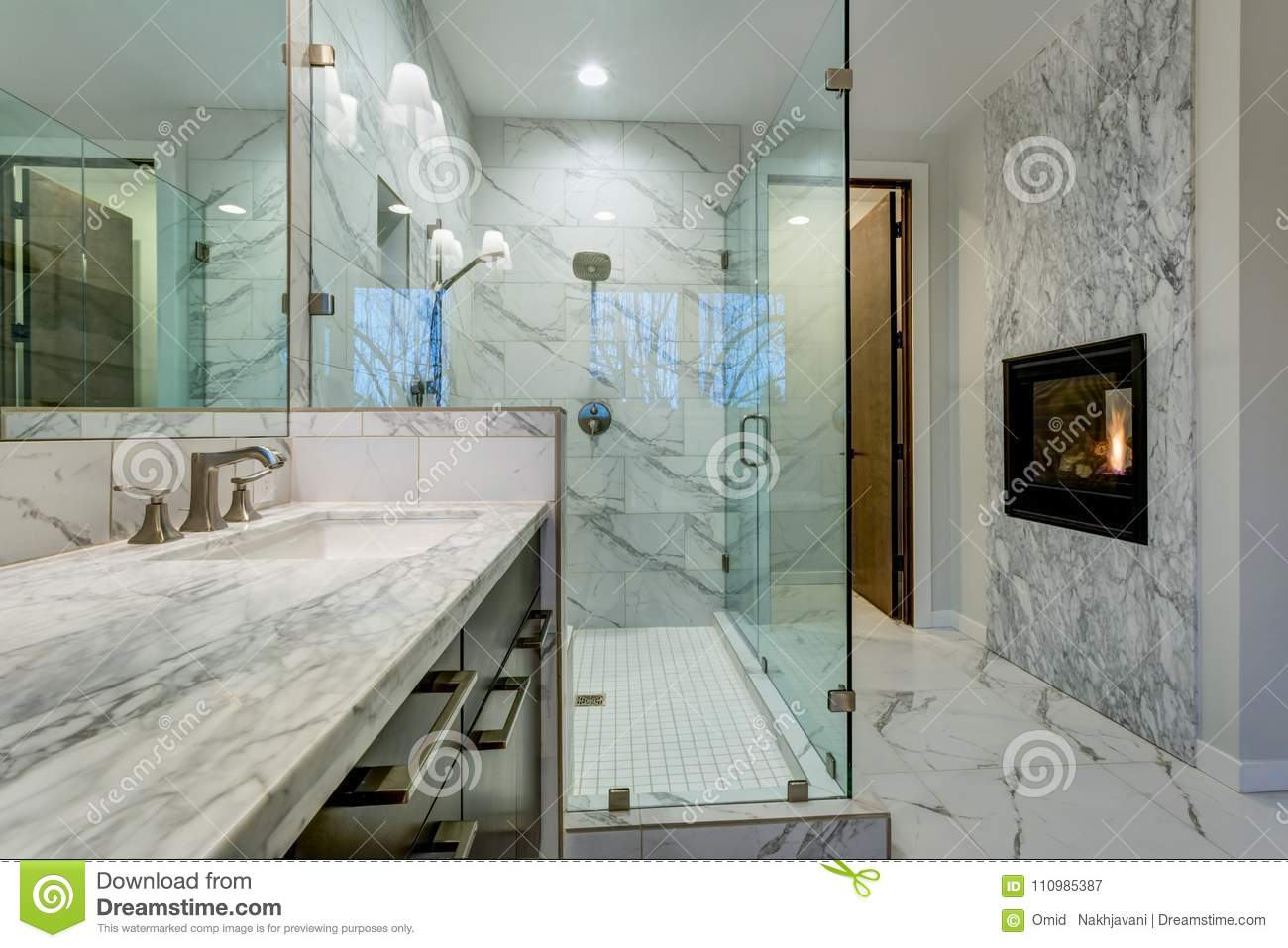 Incredible Master Bathroom With Fireplace, Carrara Marble Tile Surround,  Modern Glass Walk In Shower, Espresso Dual Vanity Cabinet And A  Freestanding ...