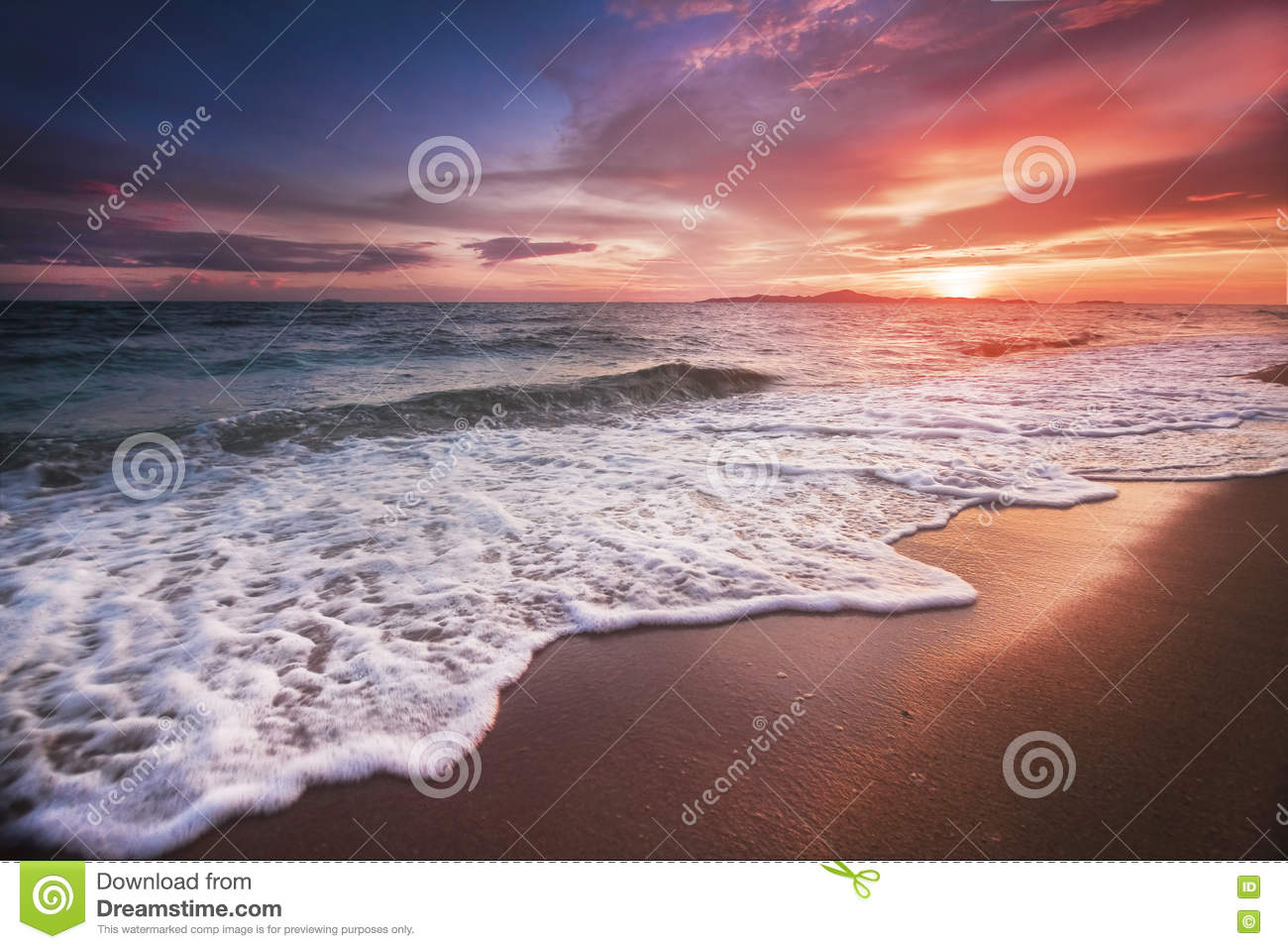 Incredibly beautiful sunset on the beach in Thailand. Sun, sky, sea, waves and sand. A holiday by the sea