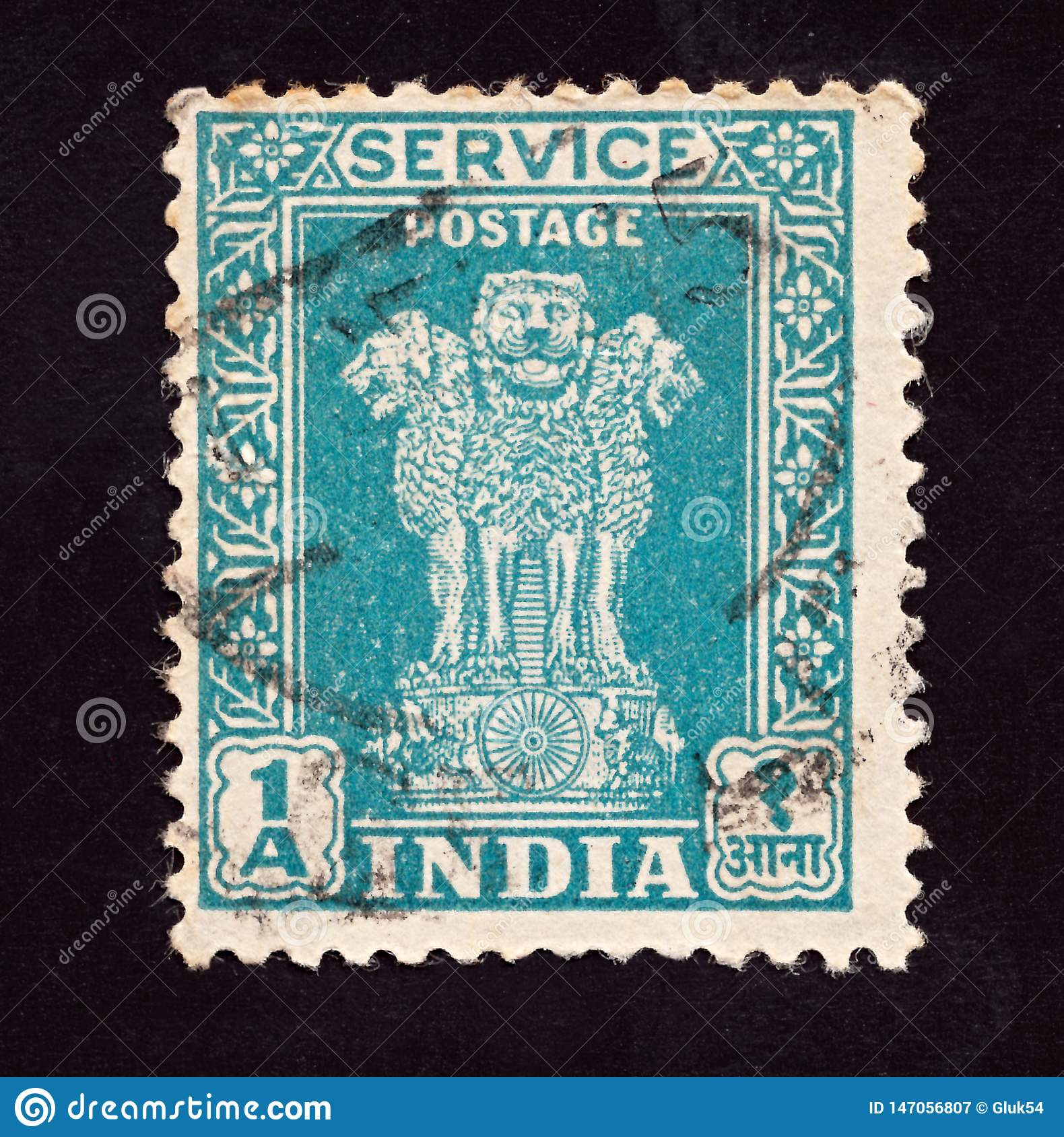 INDIA - CIRCA 1950: Cancelled postage stamp printed by  Indian mind shows four Indian lions capital of Ashoka Pillar, circa 1950