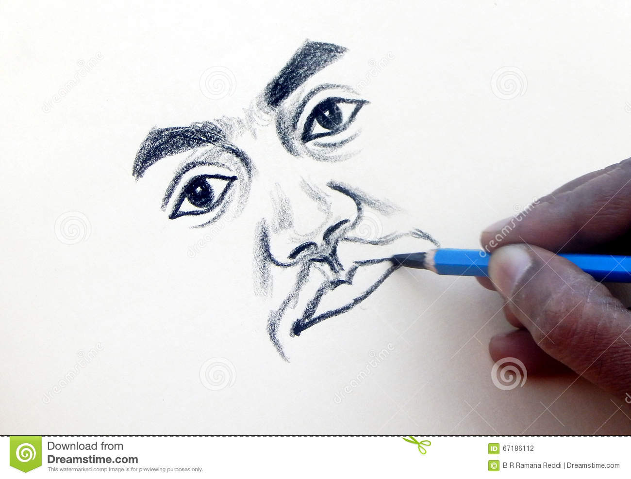 Indian artist drawing with pencil on a paper a portrait of man