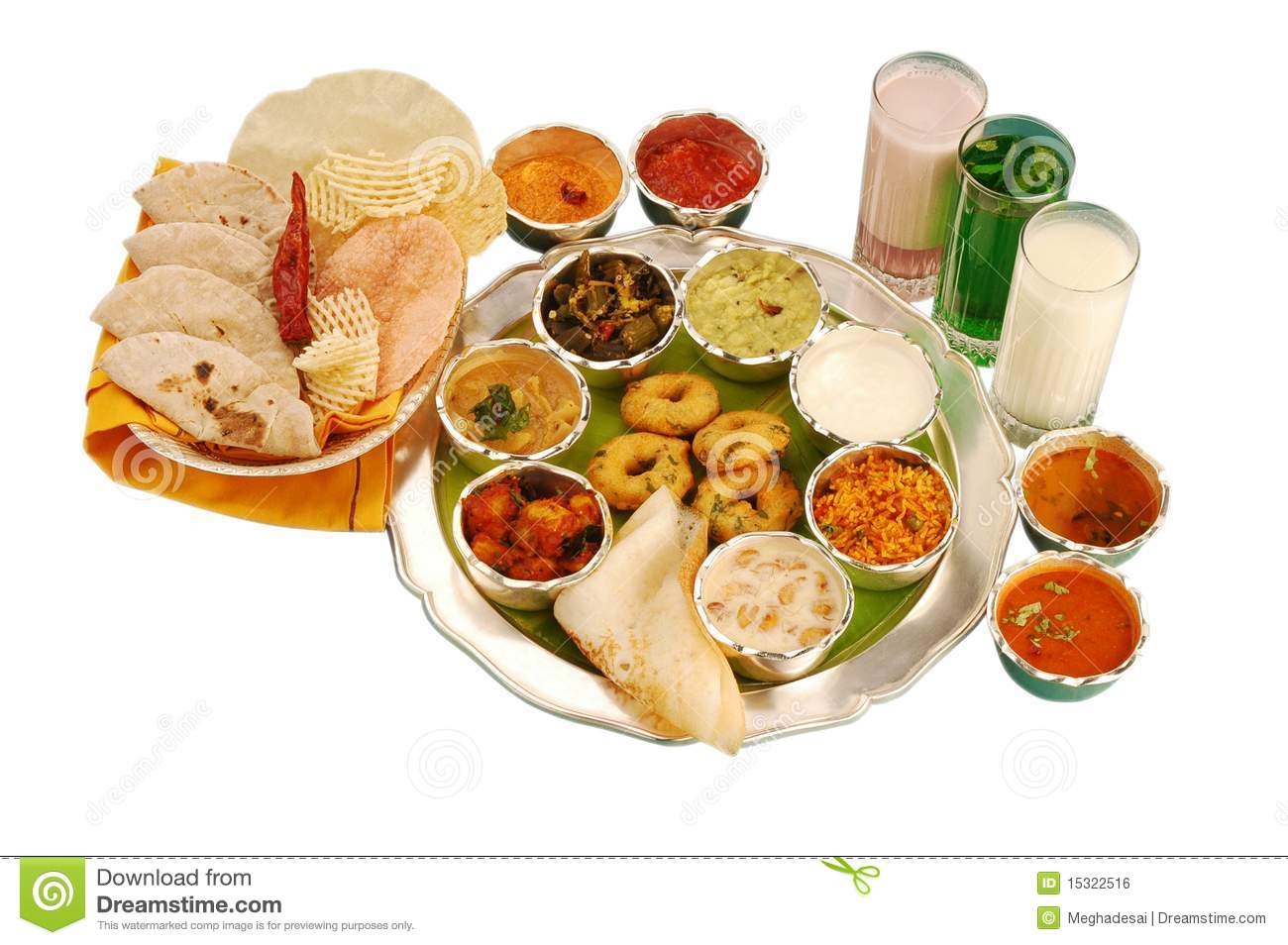 Indian meal with rice, drink, vegetables, chapaties, papad and south ...