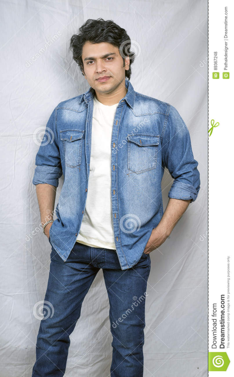 cde207b09 Indian Boy In Blue Jeans And Blue Shirt Stock Photo - Image of ...