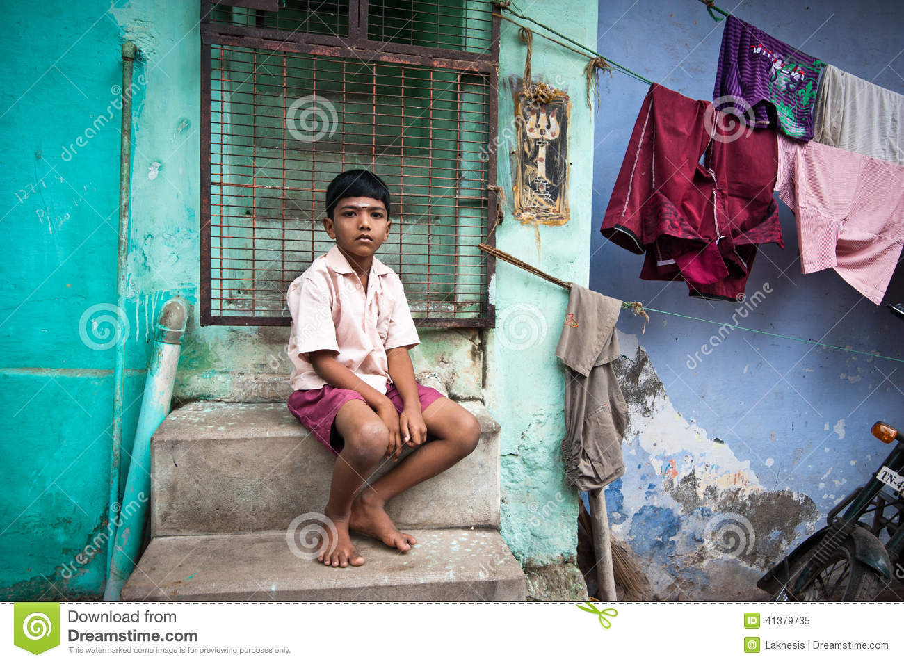 Indian Boy Sitting Near Colorful Wall His House