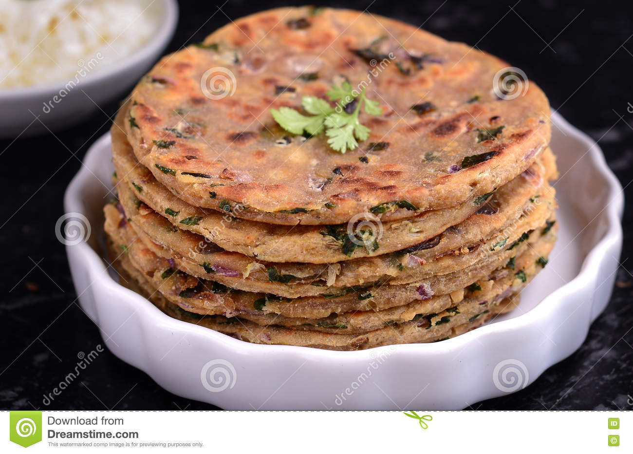 Indian breakfast consisting of parantha and curd